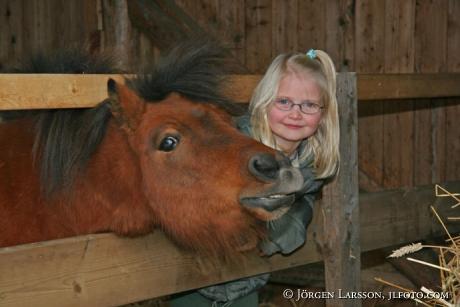 Girl with Shetland pony
