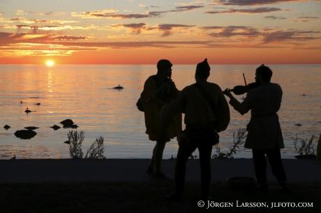 Spelmän i solnedgången