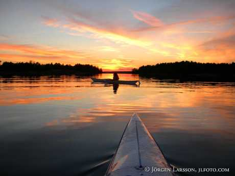 Canoing in sunset Smaland Sweden