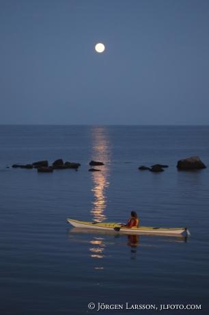 Canoeing in moonlight Smaland Sweden